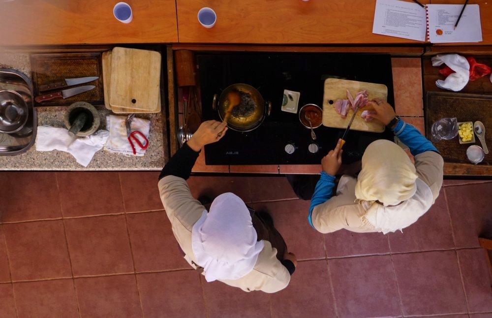 Our wonderful teachers demonstrating how to make Kari Ayam