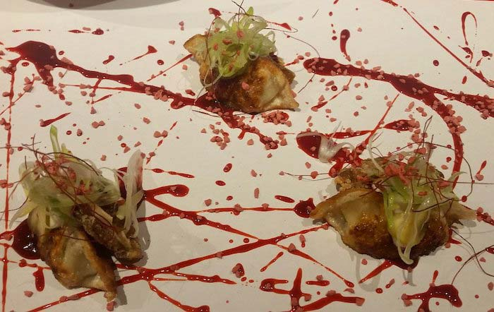 Pekinese dumplings and Pig's ear with strawberry hoisin sauce
