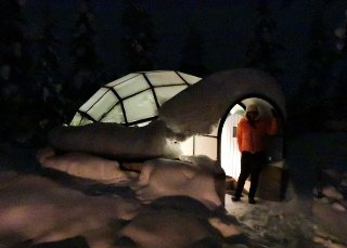 Staying in a glass igloo, Finland